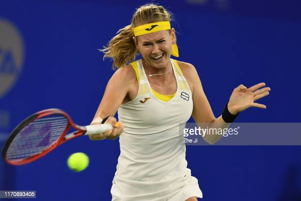 Marie Bouzkova of the Czech Republic returns a shot during the match against Qiang Wang of China on Day 3 of 2019 Dongfeng Motor Wuhan Open at Optics...