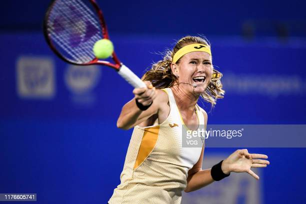 Marie Bouzkova of the Czech Republic returns a shot in the second round match against Tamara Zidansek of Slovenia on Day two of 2019 Dongfeng Motor...