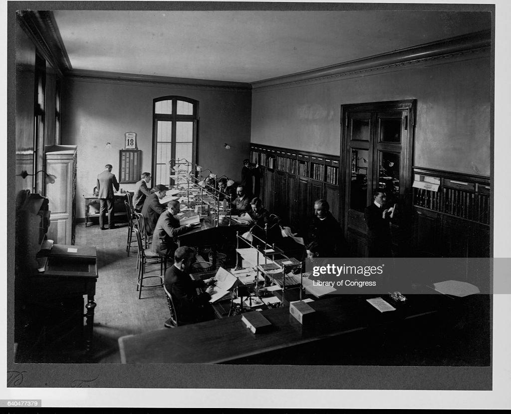 (Marie Brizard Distillery Bordeaux13 men working in office; 3 photoprints by Panajou Freres, Bordeaux, France, 1905 Lot 6824