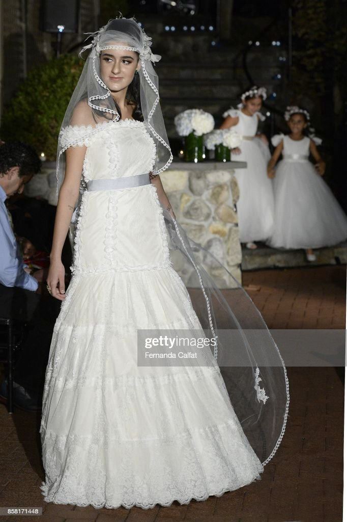 Marie Calfat Nascimento walks the Po de Arroz runway show at New York Fashion Week Bridal October 2017 at Hendrick's Tavern on October 5, 2017 in Roslyn, New York.