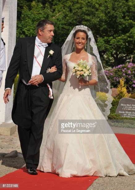 Marie Cavallier arrives with her father Alain Cavallier before her wedding to Prince Joachim of Denmark on May 24, 2008 at the Mogeltonder church in...