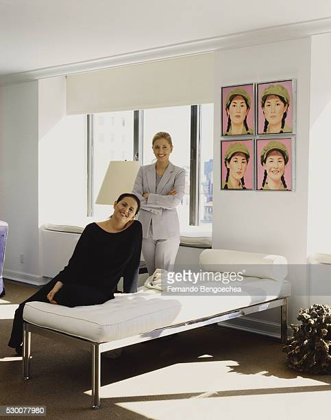 marie chantal (r) and muriel brandolini by white daybed in living room - marie brandolini stock pictures, royalty-free photos & images