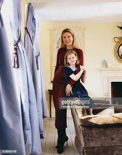 marie christine de laubarede and daughter standing near curtains - fernando bengoechea stock pictures, royalty-free photos & images