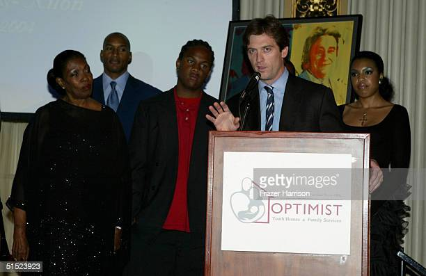 Marie Claire Beauvais, actor Henry Simmons, Oliver Saunders, Mike Nilon and Marie Beaubien are seen onstage accepting the 2004 Mentor Award on behalf...