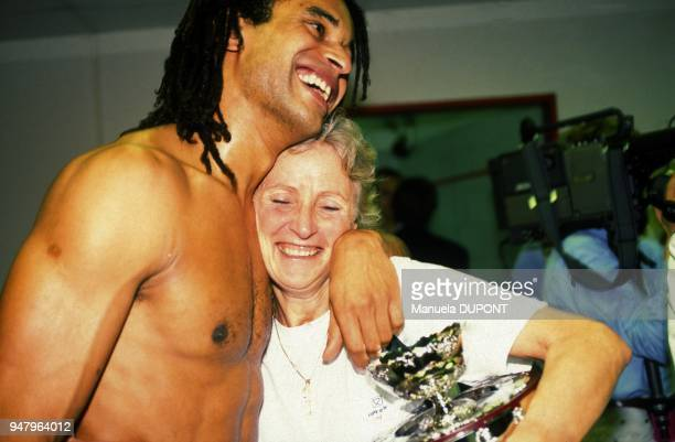 Marie Claire Noah and son Yannick after victory of French tennis team in the Davis Cup against United States, on December 1, 1991.
