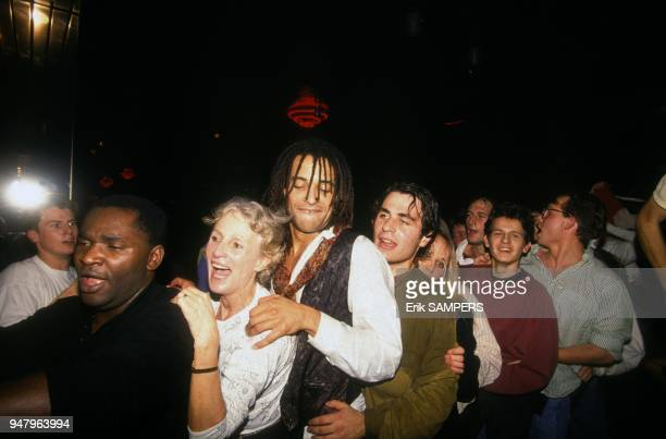 Marie Claire Noah and son Yannick during party after victory of French tennis team in the Davis Cup against United States, on December 1, 1991.