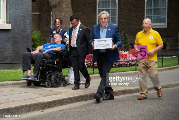 Marie Curie ambassador and actor Jim Carter hands in a petition alongside health care professionals and sufferers of Motor Nuerones Disease to 10...