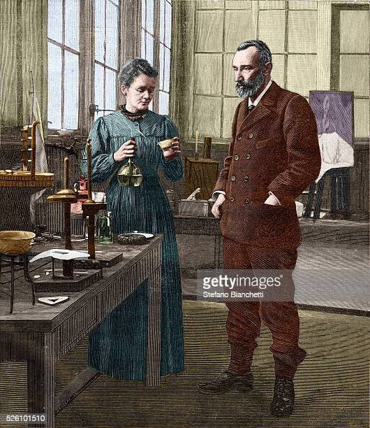 Marie Curie and Pierre Curie shown in their laboratory on rue Lhomond in Paris