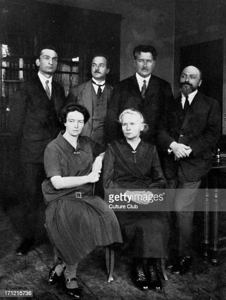 Marie Curie at the Institute of Radium in Paris In the front row are Irene Curie Marie Curie and their coworker Andre Debierne MC Polishborn French...