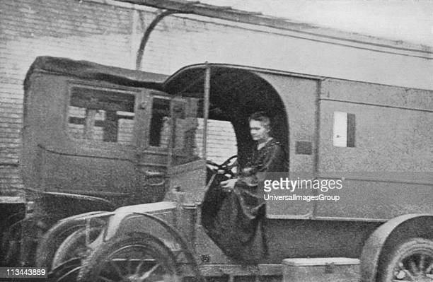 Marie Curie Polishborn French physicist driving the Renault car converted into a radiological unit which from August 1914 she drove from hospital to...
