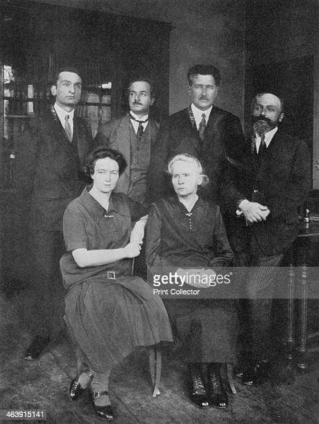 Marie Curie Polishborn French physicist Marie Curie with her daughter Irene JoliotCurie and members of the Institute of Radium Paris On the right is...