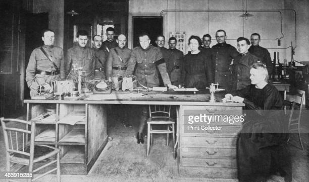 Marie Curie Polishborn French physicist together with her daughter Irene and pupils from the American Expeditionary Corps at the Institute of Radium...