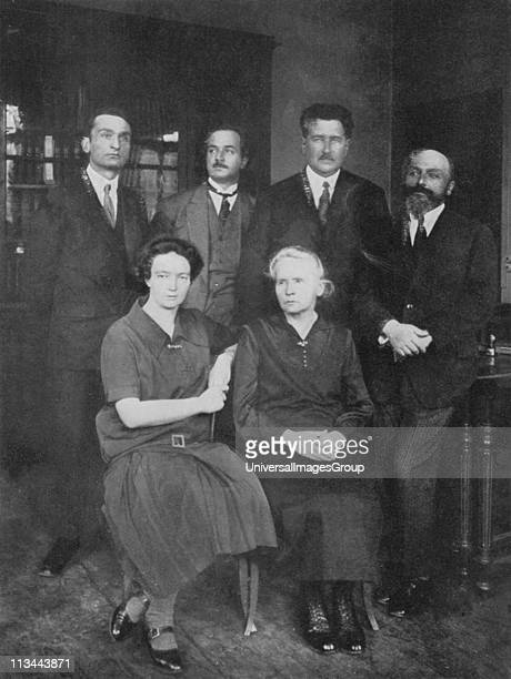 Marie Curie Polishborn French physicist with her daughter Irene JoliotCurie with members of the Institute of Radium Paris On the right is their...