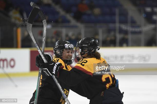 Marie Delarbre of Germany celebrates scoring a goal with team mates Tanja Eisenschmid during the Women's Ice Hockey Olympic Qualification Final game...