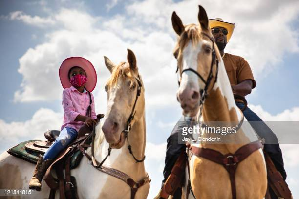 Marie Dixon,6 and her dad Kris, from Moreno Valley, came to ride with the Compton Cowboys, preparing their horses at the Gateway Towne Center, before...