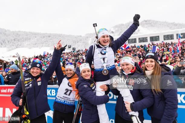 Marie Dorin Habert Anais Chevalier Celia Aymonier 1st place Justine Braisaz Anais Bescond and Chloe Chevalier of the French Team celebrate following...