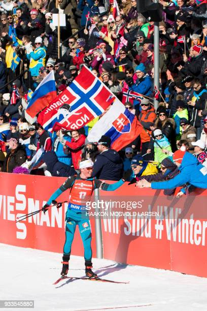 Marie Dorin Habert from France smiles as she crosses the finish line of the IBU Biathlon World Cup Women's 10 km Pursuit event in Holmenkollen Oslo...