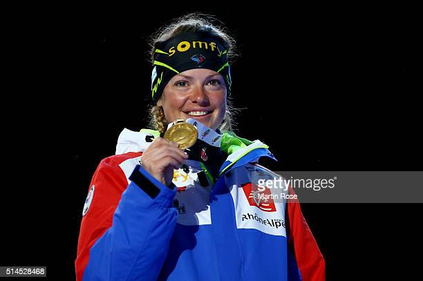 Marie Dorin Habert of France celebrates the gold medal in the women's 15km individual during day six of the IBU Biathlon World Championships at Medal...