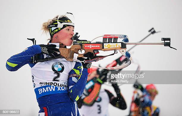 Marie Dorin Habert of France checks her rifle during the Women's 125km Biathlon race of the Ruhpolding IBU Biathlon World Cup on January 16 2016 in...