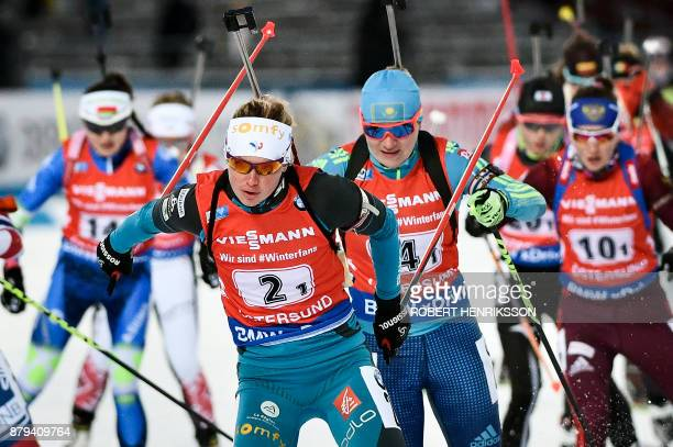 Marie Dorin Habert of France is followed by Kazakhstan's Galina Vishnevskaya during the Single Mixed Relay event of the IBU Biathlon World Cup in...
