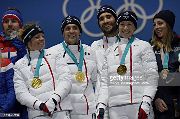 Marie Dorin Habert of France, Simon Desthieux of France, Anais Bescond of France, Martin Fourcade of France win the gold medal of the biathlon mixed...