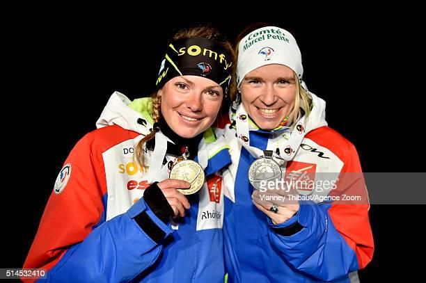 Marie Dorin Habert of France wins the gold medal Anais Bescond of France wins the silver medal during the IBU Biathlon World Championships Women's...