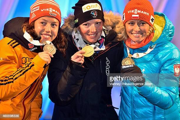 Marie DorinHabert of France takes 1st place Laura Dahlmeier of Germany takes 2nd place Weronika NowakowskaZiemniak of Poland takes 3rd place during...