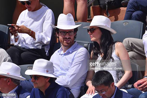 Marie Drucker and a guest attend the Men's Singles Final of 2015 Roland Garros French Tennis Open Day Fithteen on June 7 2015 in Paris France