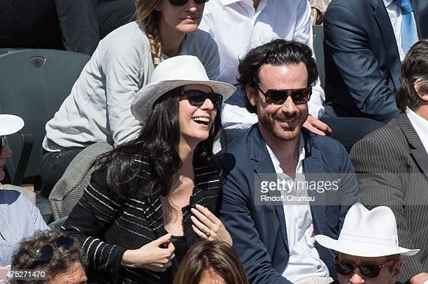 Marie Drucker and her companion Mathias Vicherat attend the French Open 2015 at Roland Garros on May 30 2015 in Paris France