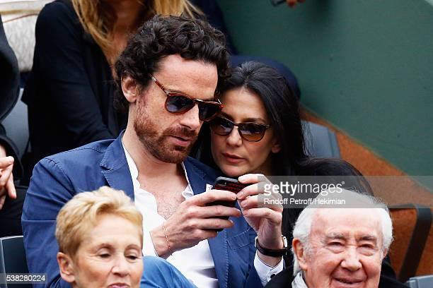 Marie Drucker and her companion Mathias Vicherat attend the French Tennis Open Day Fifteen with the Final between Novak Djokovic and Andy Murray at...