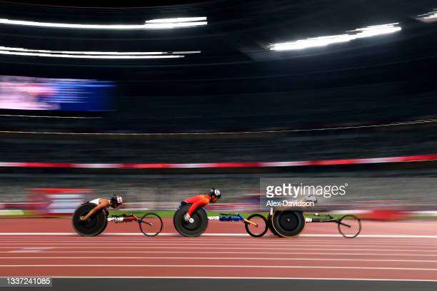 Marie Emmanuelle Anais Alphonse of Team Mauritius, Lihong Zou of Team China and Manuela Schaer of Team Switzerland compete in her women's 1500m - T54...