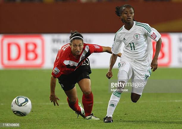 Marie Eve Nault of Canada and Glory Iroka of Nigeria battle for the ball during the FIFA Women's World Cup 2011 Group A match between Canada and...