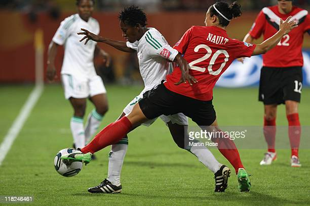 Marie Eve Nault of Canada and Ogonna Chukwudi of Nigeria battle for the ball during the FIFA Women's World Cup 2011 Group A match between Canada and...