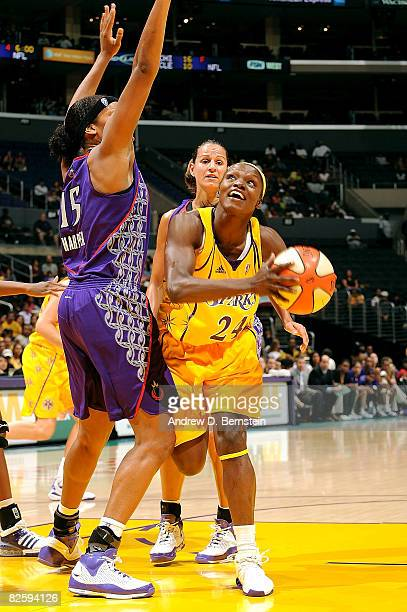 Marie FerdinandHarris of the Los Angeles Sparks attempts a shot during the game against Laura Harper of the Sacramento Monarchs on August 28 2008 at...