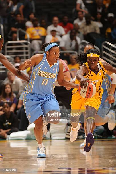 Marie FerdinandHarris of the Los Angeles Sparks attempts a steal from Jia Perkins of the Chicago Sky during the game on June 18 2008 at Staples...