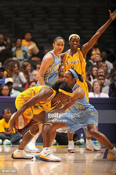 Marie FerdinandHarris of the Los Angeles Sparks defends the ball as Jia Perkins of the Chicago Sky reaches in during the game on June 18 2008 at...