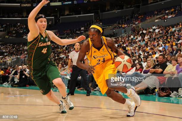 Marie FerdinandHarris of the Los Angeles Sparks drives past Katie Gearlds of the Seattle Storm on September 14 2008 at Staples Center in Los Angeles...