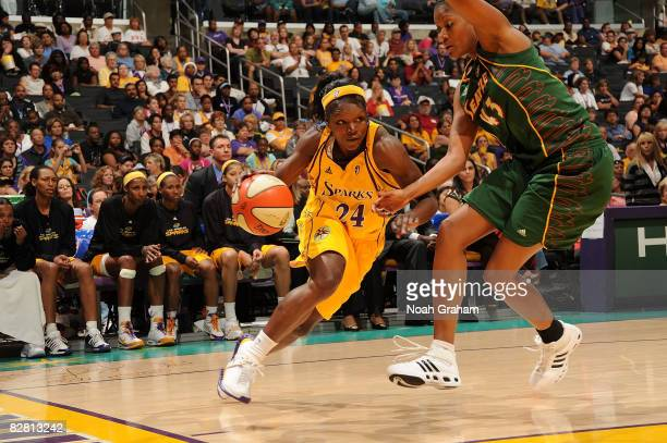 Marie FerdinandHarris of the Los Angeles Sparks drives the ball against Ashley Robinson of the Seattle Storm on September 14 2008 at Staples Center...