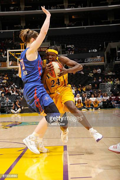 Marie FerdinandHarris of the Los Angeles Sparks drives to the basket against Katie Smith of the Detroit Shock at Staples Center on June 11 2008 in...