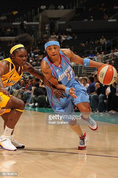 Marie Ferdinand-Harris of the Los Angeles Sparks guards against Betty Lennox of the Atlanta Dream on September 11, 2008 at Staples Center in Los...