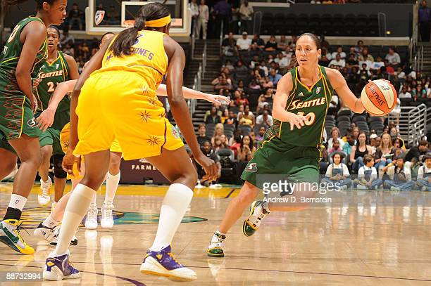 Marie FerdinandHarris of the Los Angeles Sparks guards as Sue Bird of the Seattle Storm drives the ball during the game on June 28 2009 at Staples...