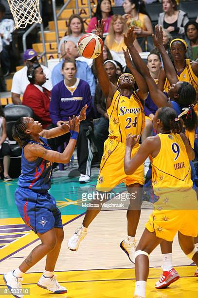 Marie FerdinandHarris of the Los Angeles Sparks loses the ball on her way to the basket while taking on the Detroit Shock at Staples Center on June...