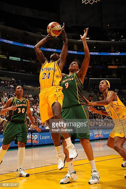 Marie Ferdinand-Harris of the Los Angeles Sparks makes a shot against Katie Gearlds of the Seattle Storm on September 14, 2008 at Staples Center in...