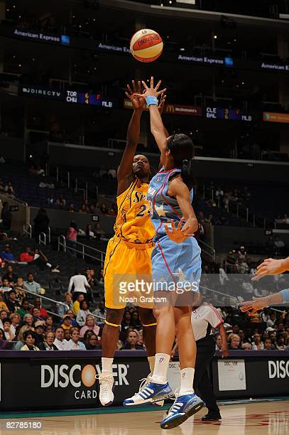 Marie Ferdinand-Harris of the Los Angeles Sparks shoots over Iziane Castro Marques of the Atlanta Dream on September 11, 2008 at Staples Center in...