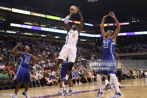 Marie FerdinandHarris of the Phoenix Mercury attempts a shot during the WNBA game against the New York Liberty at US Airways Center on August 23 2011...
