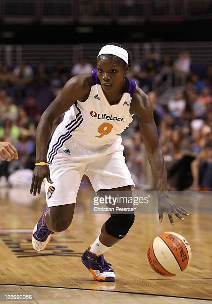 Marie FerdinandHarris of the Phoenix Mercury handles the ball against the Los Angeles Sparks during the WNBA game at US Airways Center on September 3...
