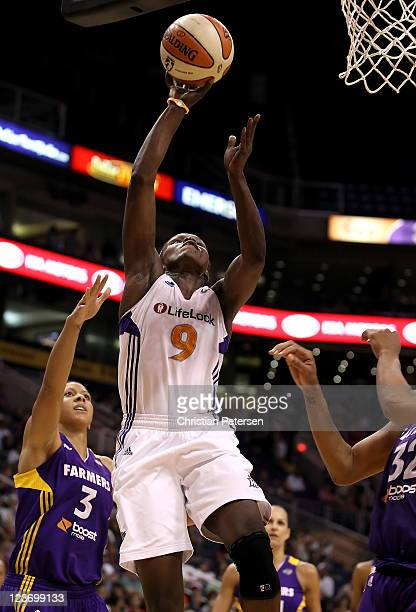 Marie FerdinandHarris of the Phoenix Mercury puts up a shot against the Los Angeles Sparks during the WNBA game at US Airways Center on September 3...