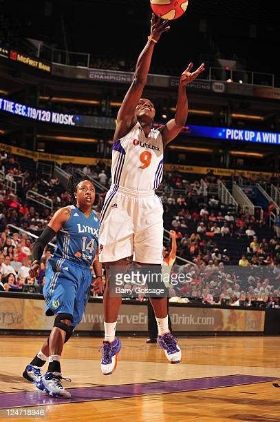 Marie FerdinandHarris of the Phoenix Mercury shoots against Alexis Hornbuckle of the Minnesota Lynx on September 11 2011 at US Airways Center in...