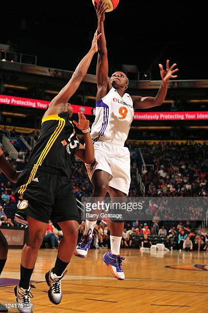 Marie FerdinandHarris of the Phoenix Mercury shoots against Karima Christmas of the Tulsa Shock on September 8 2011 at US Airways Center in Phoenix...