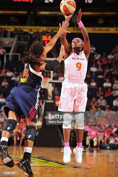 Marie FerdinandHarris of the Phoenix Mercury shoots against Tan White of the Connecticut Sun on August 7 2011 at US Airways Center in Phoenix Arizona...
